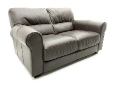 Three seat sofa and matching two seater upholstered in brown leather
