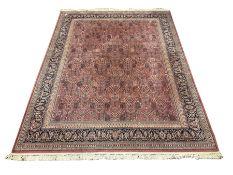 Large Persian design red ground carpet