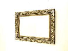 Rectangular wall mirror in leaf moulded frame