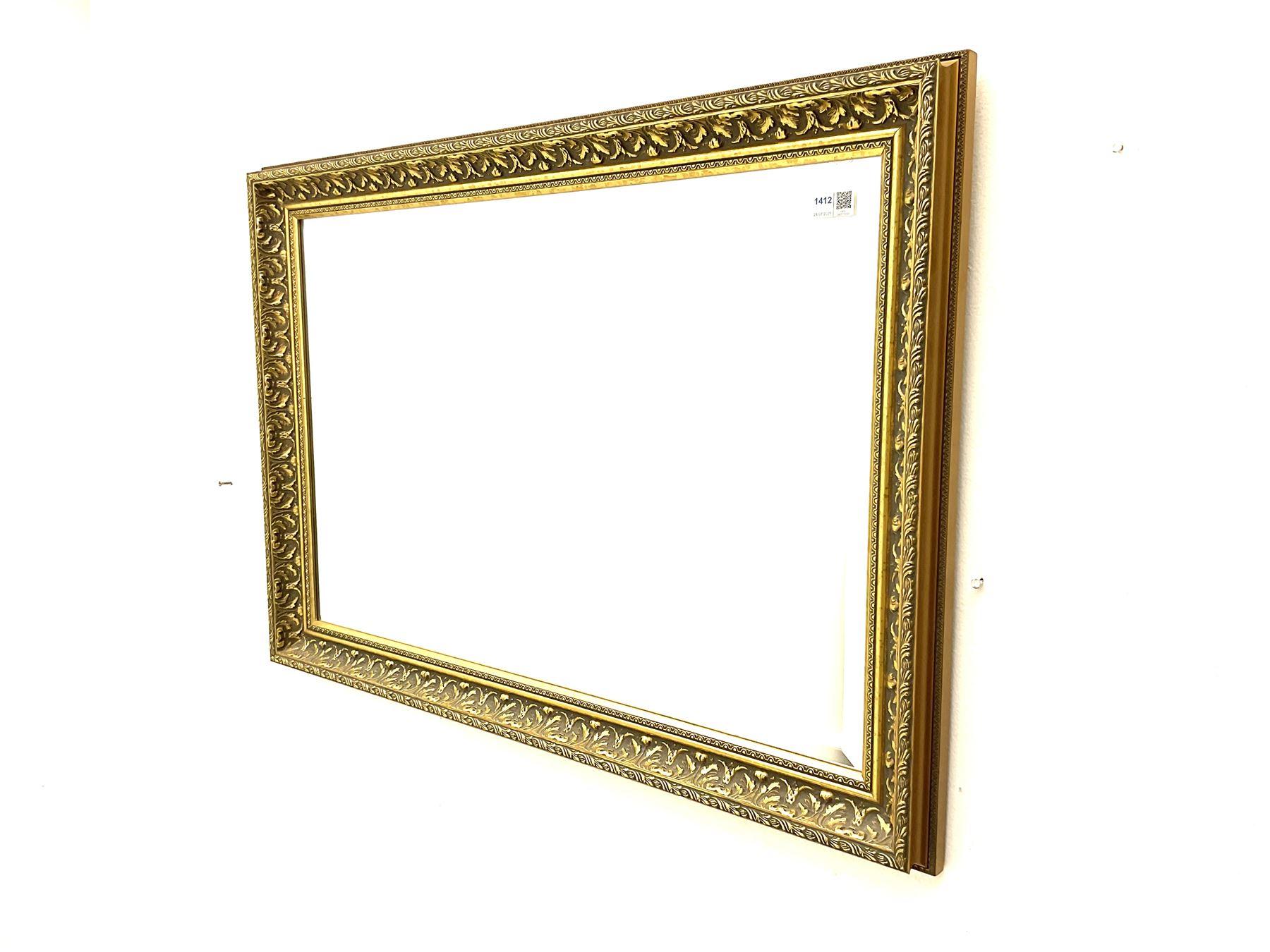 Rectangular ribbed gilt framed bevelled edge wall mirror and a rectangular wall mirror in swag frame