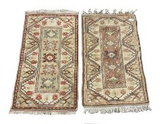 Two pale ground Turkish rugs