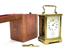 Early 20th century brass and bevel glazed carriage alarm clock