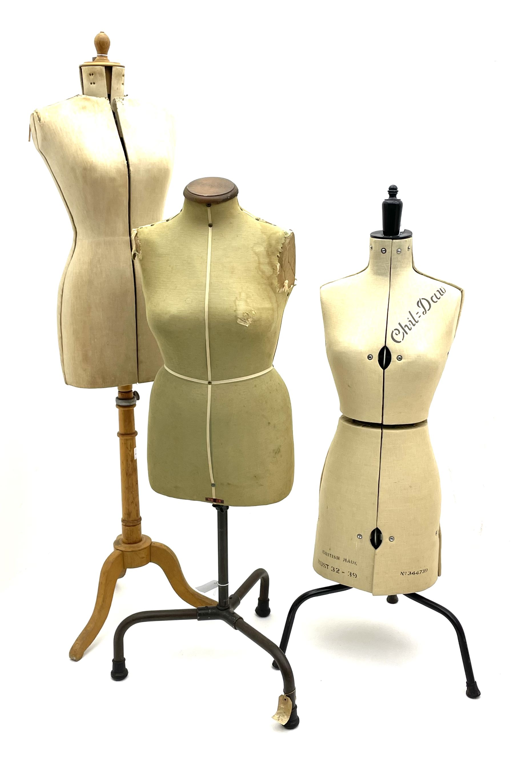 Three dress makers mannequins