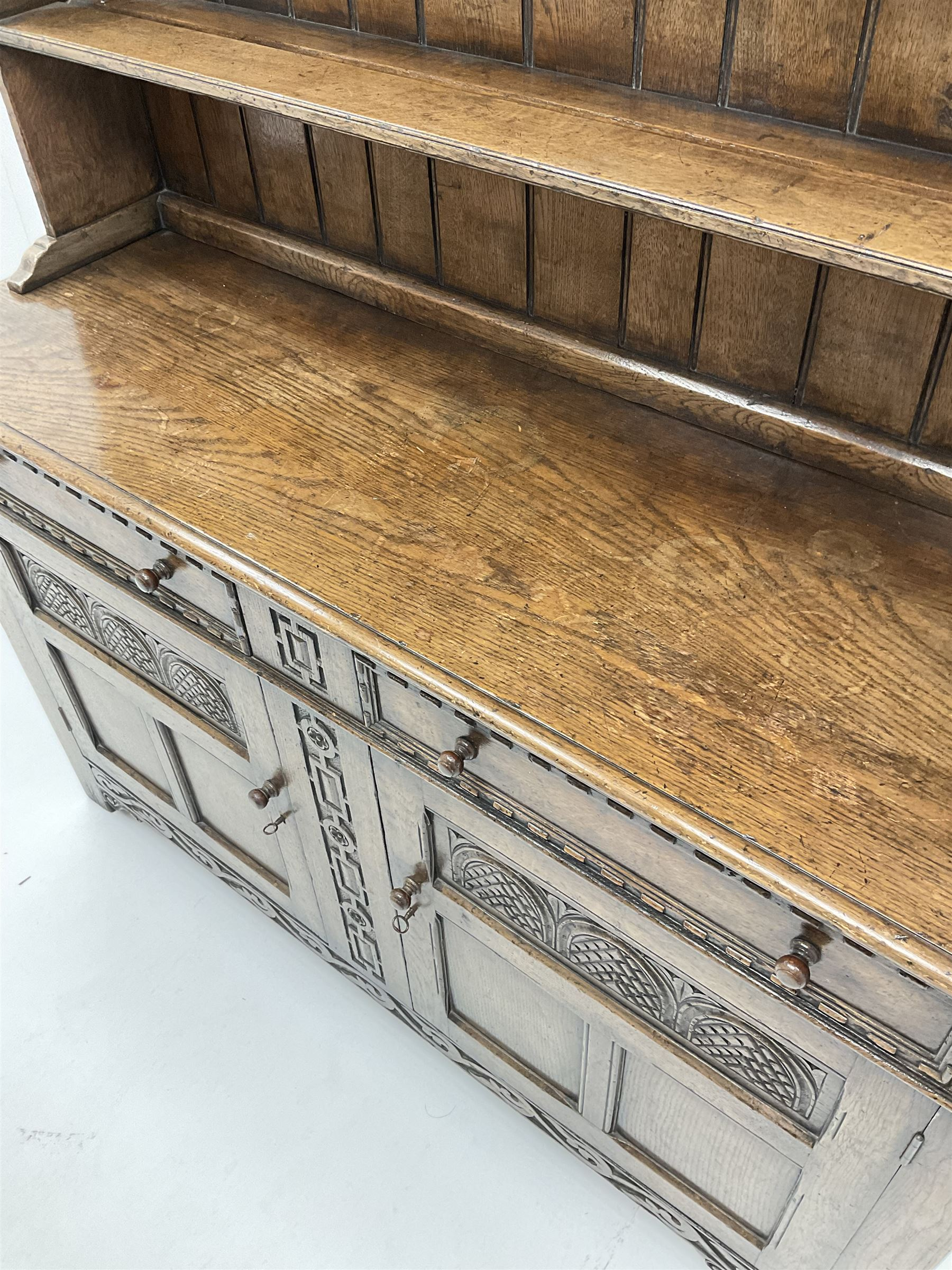 Jacobean style carved oak dresser fitted two drawers and two cupboards - Image 2 of 2