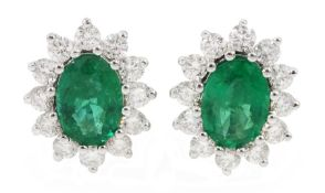Pair of 18ct white gold oval emerald and diamond cluster stud earrings