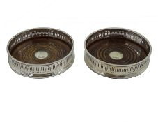 Pair of silver mounted oak coasters