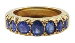Gold graduating seven stone vari-cut sapphire ring