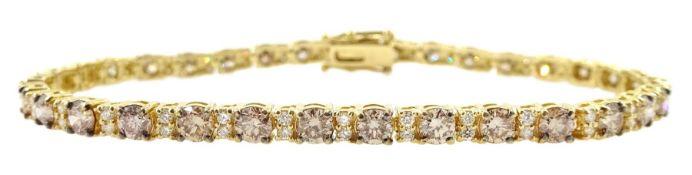 Gold round brilliant cut diamond champagne and white diamond bracelet