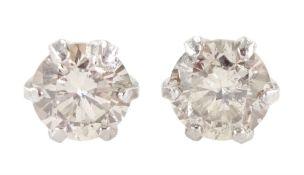 Pair of platinum round brilliant cut diamond stud earrings