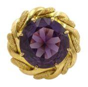 18ct gold circular purple stone ring