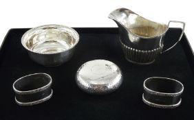 Edwardian silver circular box with hinged lid and hammered decoration by John Millward Banks