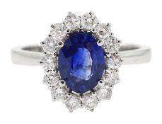 18ct white gold fine oval Ceylon sapphire and round brilliant cut diamond cluster ring