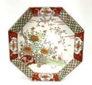 Japanese octagonal charger enamelled to the centre with flowers and blossom within a border of alter