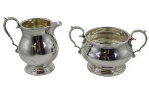 Silver milk jug and sugar bowl