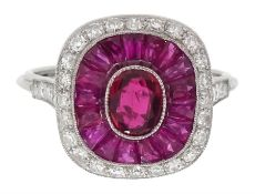 Platinum ring set with central oval ruby