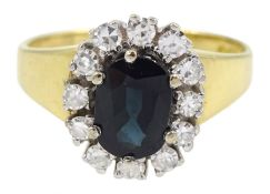 18ct gold oval sapphire and diamond cluster ring