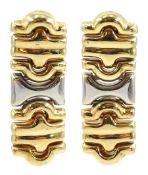 Pair of gold pendant stud earrings
