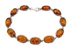 Silver oval Baltic amber link bracelet