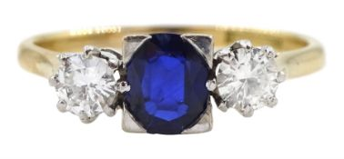 Gold three stone oval sapphire and round brilliant cut diamond ring