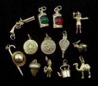 Twelve 9ct gold charms including acorn