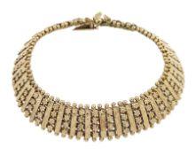 9ct gold bar and floral design fancy link bracelet