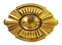 Victorian Etruscan revival gold brooch set with an oval citrine