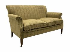 Early 20th century beech framed settee upholstered in a foliate striped fabric