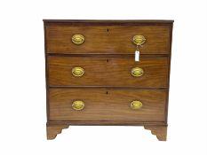 Early 19th century mahogany three drawer chest on bracket feet