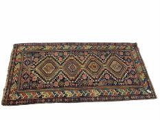 Persian navy blue ground geometric pattern rug