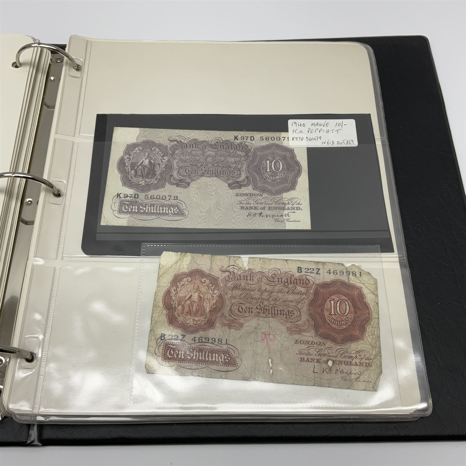 Album of mostly Great British banknotes including Peppiatt emergency issue one pound 'E57E' - Image 5 of 19