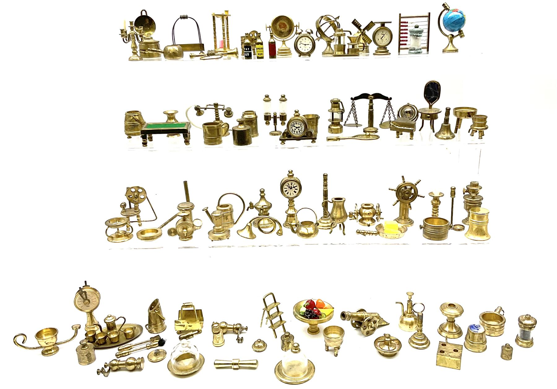 Over one-hundred various scale miniature brass ornaments suitable for decorating doll's houses inclu