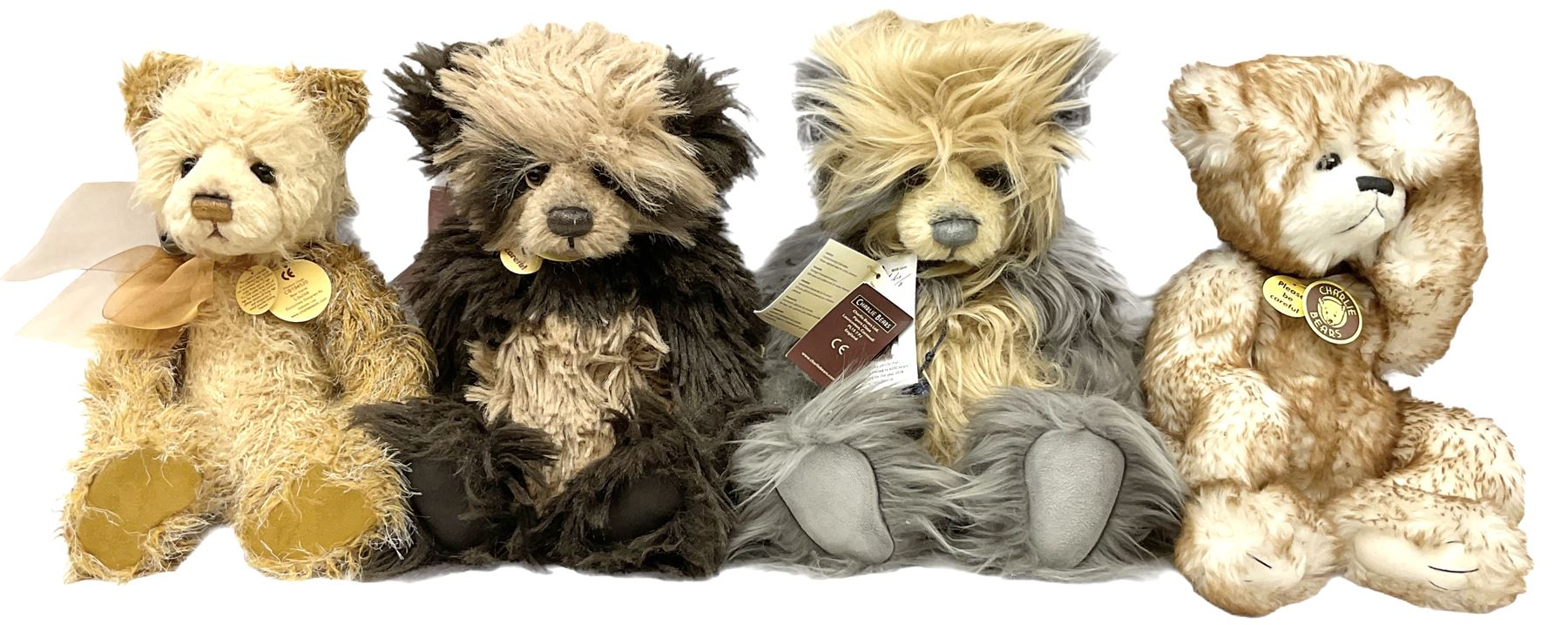 Four Charlie Bears - 'Parker' designed by Heather Lyell No.CB110307; 'Louise' No.CB194520; 'Phoenix'