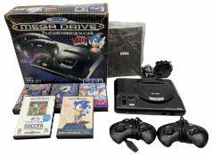 1990s Sega Megadrive 16bit games console with five games comprising Sonic the Hedgehog