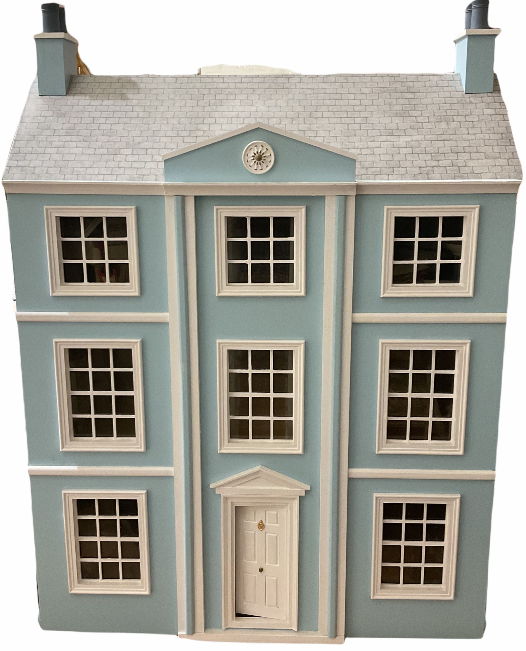 Georgian style wooden double fronted three-storey dolls house with pale blue stucco finish under a f