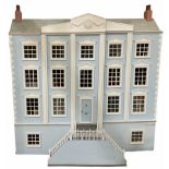 Large and impressive Georgian style wooden double fronted four-storey dolls house with pale blue stu