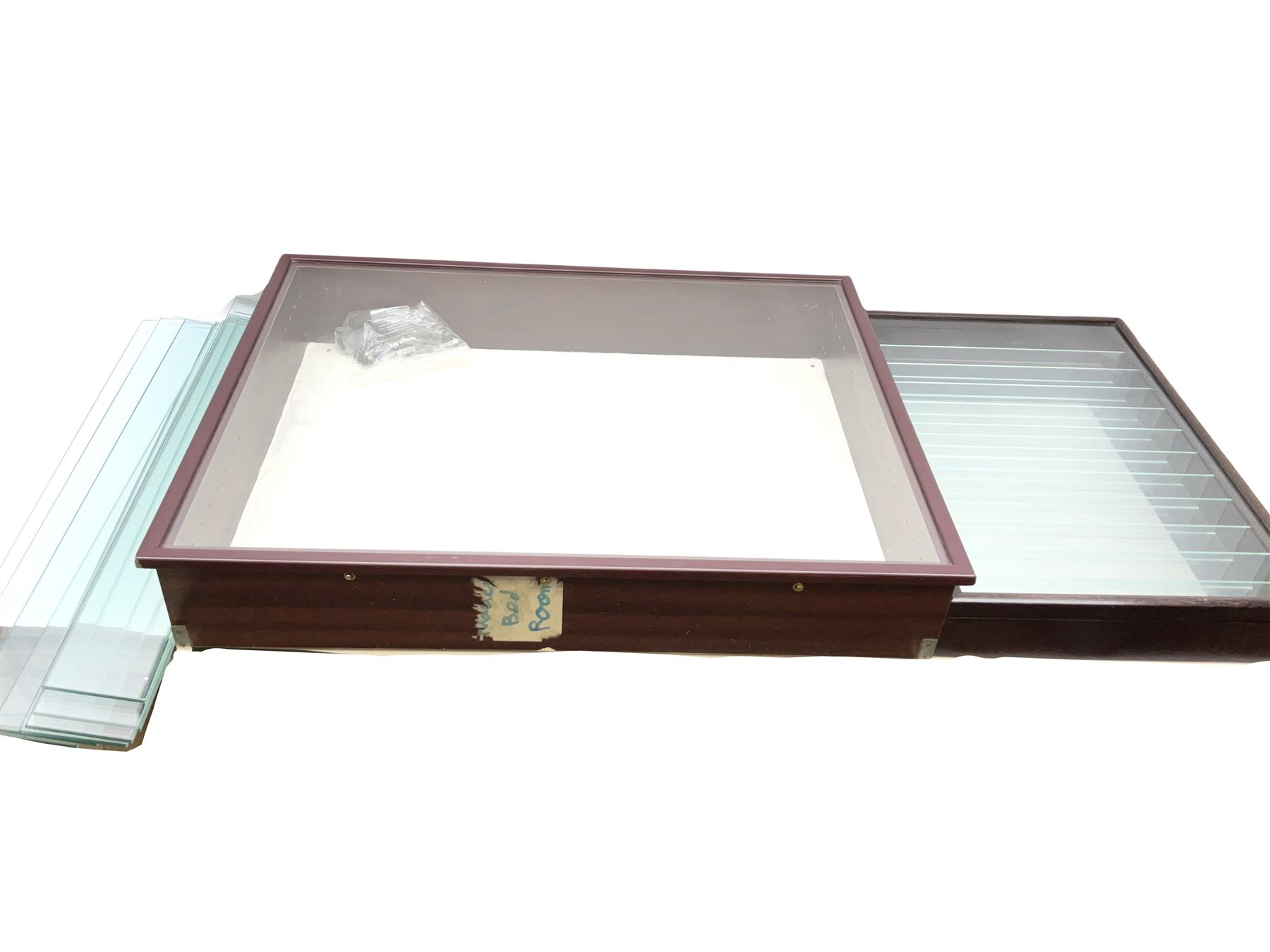 Die-cast model wall mounting display cabinet with mahogany finish and hinged glass door enclosing ei
