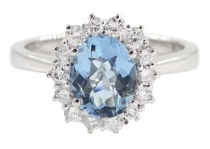 18ct white gold oval aquamarine and round brilliant cut cluster ring
