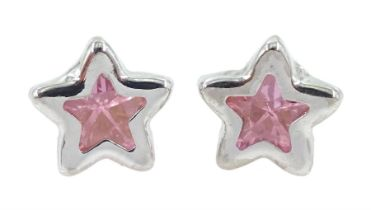 Pair of 9ct white gold purple stone star stud earrings