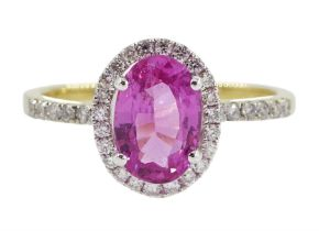 18ct gold oval pink sapphire and diamond halo cluster ring
