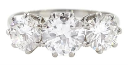 Platinum three stone round brilliant cut diamond ring