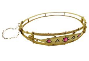 Edwardian gold diamond and pink stone set bangle
