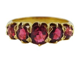 Early 20th century 18ct gold graduating five red stone set ring