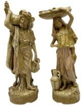 Pair of Royal Dux figures modelled as Persian male and female water carriers