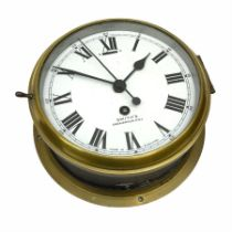 A 20th century Smiths brass cased bulkhead clock with a single train eight-day going barrel movement
