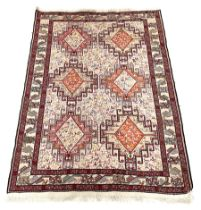 Pale ground rug