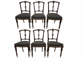 A set of six Victorian walnut dining/bedroom chairs