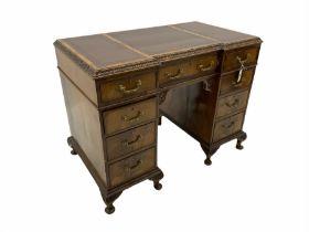 Early 20th century figured mahogany twin pedestal desk
