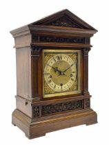 An early 20th century Winterhalder and Hofmeier German three train mantle clock chiming the quarters
