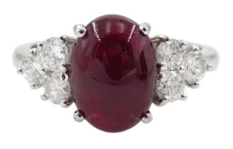 18ct white gold cabochon ruby and six brilliant cut diamond ring