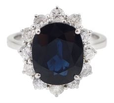 18ct white gold oval sapphire and diamond cluster ring